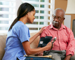 caregiver getting the blood pressure of patient